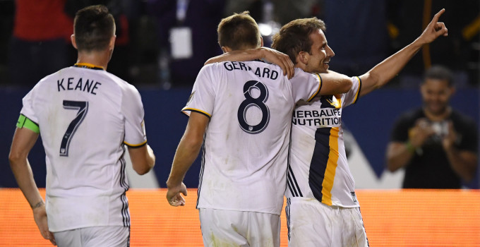 Los Angeles Galaxy forward Mike Magee, right, celebrates his gaol with midfielder Steven Gerrard, , center, of England, and forward Robbie Keane, of Ireland, during the second half of an Major League Soccer match, Sunday, March 6, 2016, in Carson, Calif. The Galaxy won 4-1. (AP Photo/Mark J. Terrill)