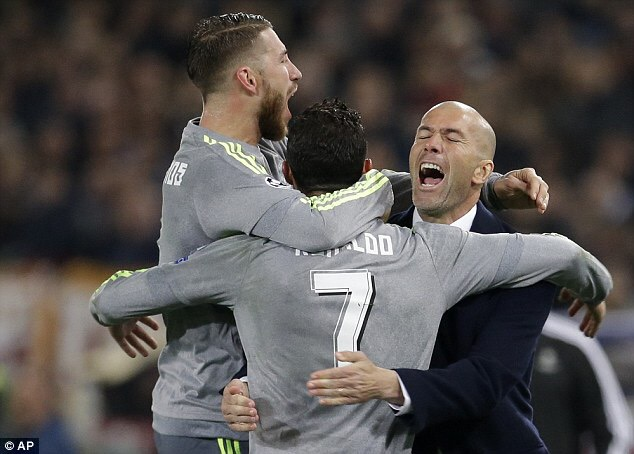 Zinedine Zidane celebrating a goal with Sergio Ramos and Cristian's Ronadlo.