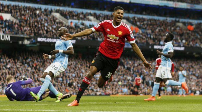 Marcus Rashford celebrating after scoring against Manchester City.