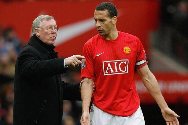 Sir Alex Ferguson talking tactics with Rio Ferdinand.