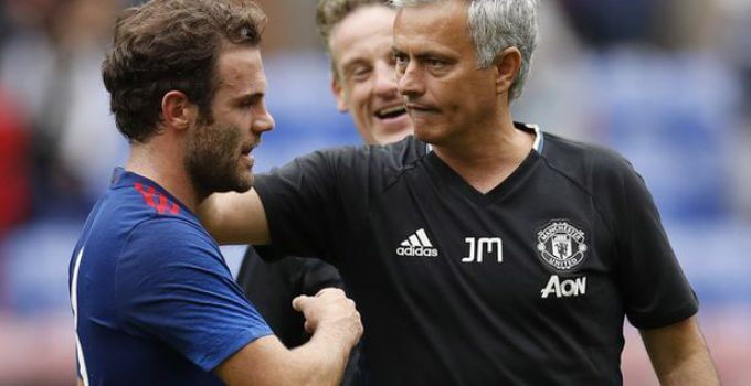 Manchester United's Juan Mata and Jose Mourinho