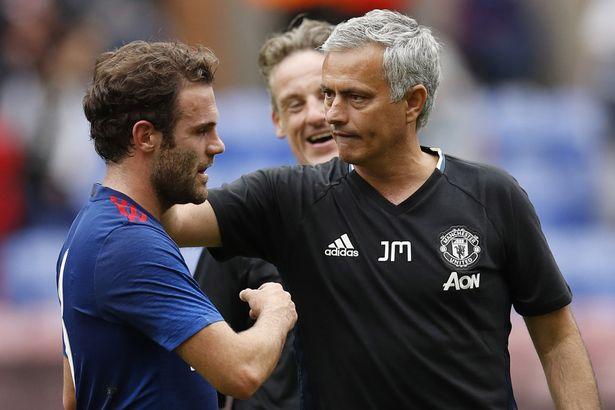 Manchester United's Juan Mata and Jose Mourinho